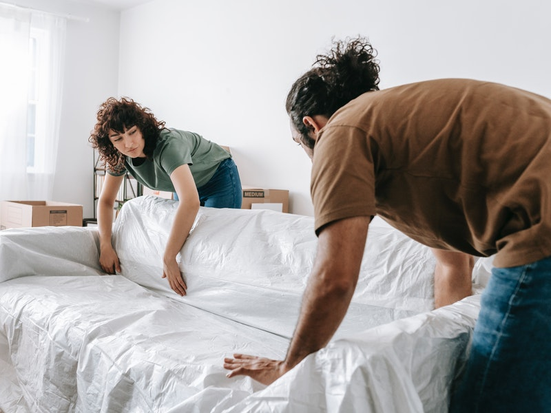 Protect furniture with covers before moving into storage